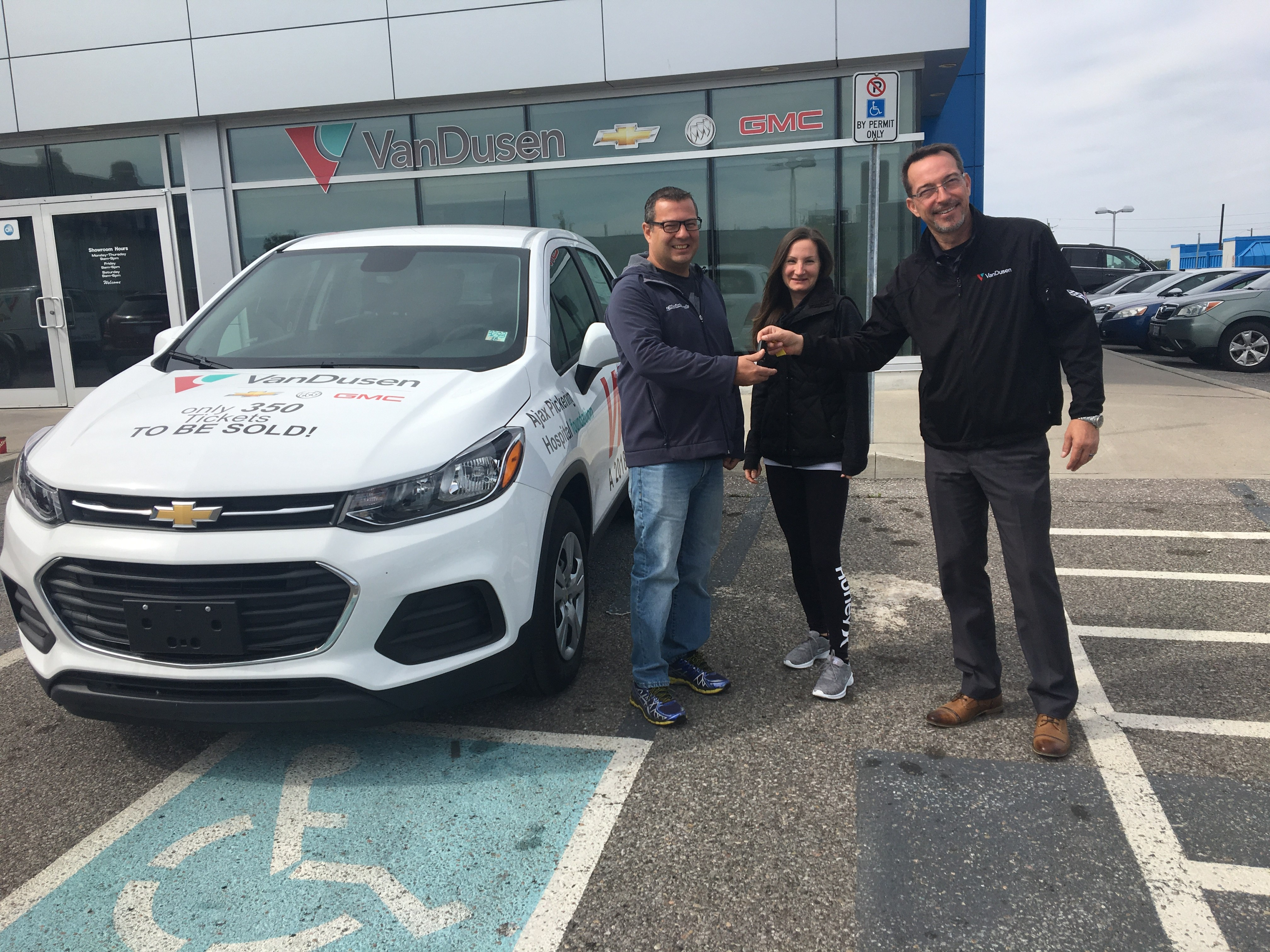 Ajax Pickering Hospital Foundation 2018 car raffle winners Mike & Tina picking up keys from Jim VanDusen Ajax Ontario